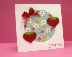 I used DOODLEBUG BERRY BLUE AGAIN and a red silk ribbon (which will be online by the end of the week) as well as the yummy HEARTY strawberries from the flirty set.  I also used the XTRA LARGE CIRCLE PUNCH BY MARVY