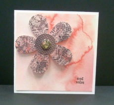 We used the EK SUCCESS paper shaper XL retro daisy flower punch, a one inch circle punch for the center and a PORCELAIN glazed brad