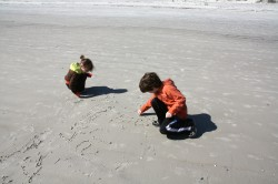 kidlets writing in the sand