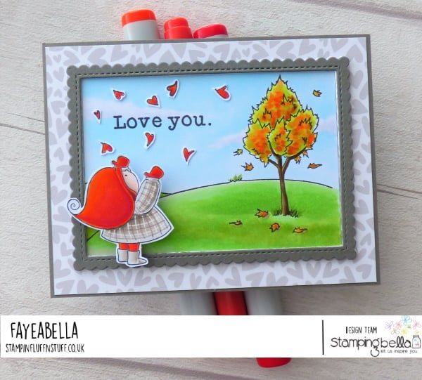 www.stampingbella.com: rubber stamp used: BUNDLE GIRL WITH FALLING HEARTS and FALL BACKDROP card by Faye Wynn Jones